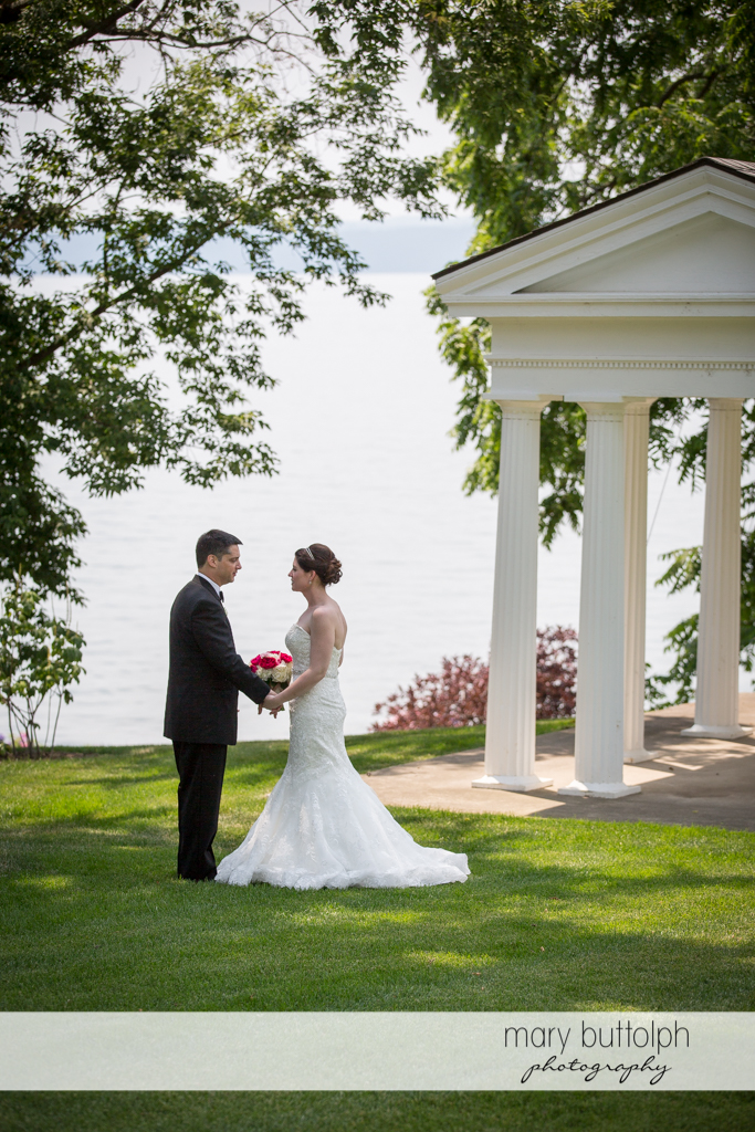 Couple pose in front of the lake at the Inns of Aurora Wedding