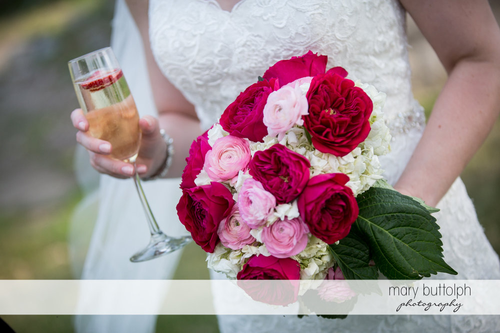 Close up shot of the bride's bouquet and glass of wine at the Inns of Aurora Wedding