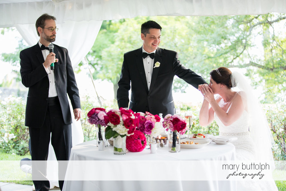 Couple get romantic at the wedding reception at the Inns of Aurora Wedding