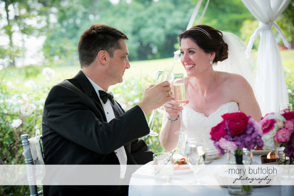 Couple toasts to the good times at the Inns of Aurora Wedding