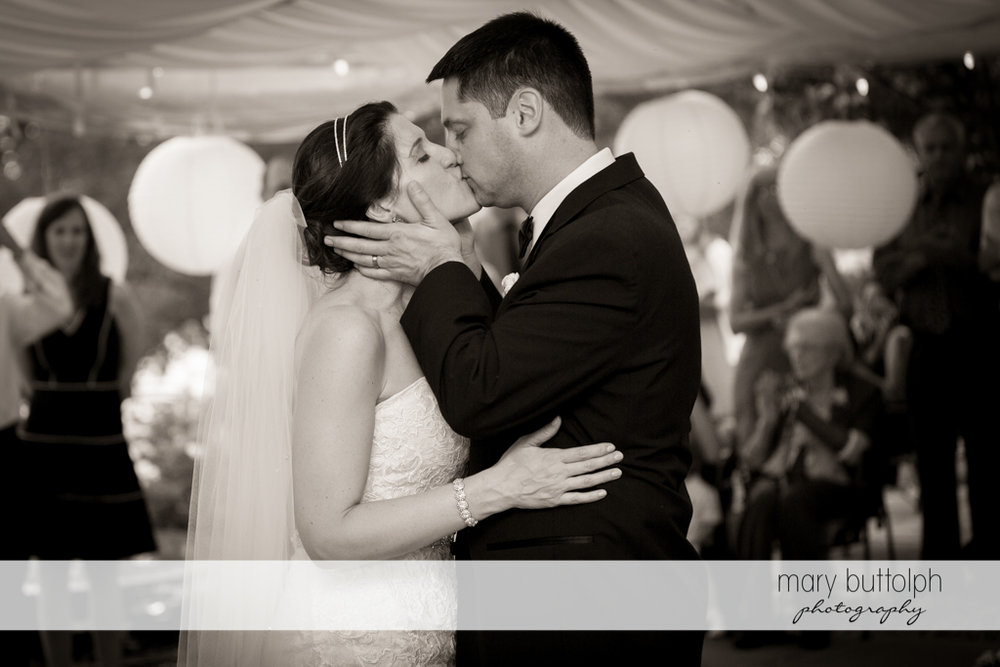 Couple kiss while dancing at the Inns of Aurora Wedding