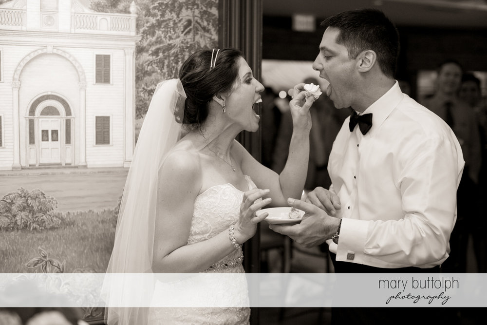Couple taste their wedding cake at the Inns of Aurora Wedding