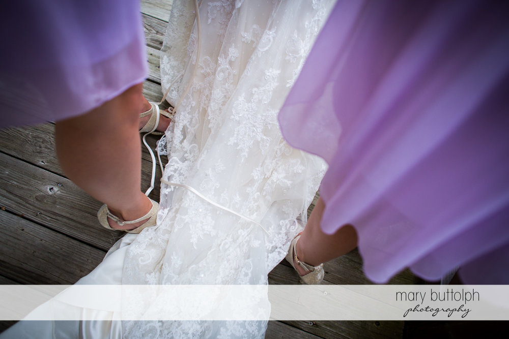 Bride's wedding gown covers the bridesmaids' feet at the Mirbeau Inn & Spa Wedding