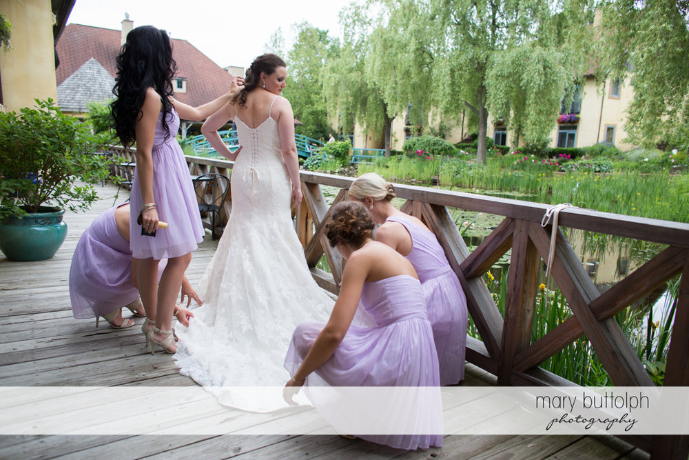 Bride and her bridesmaids on the porch at the Mirbeau Inn & Spa Wedding