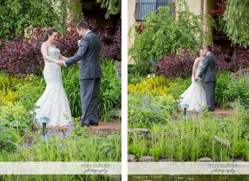 Couple meet and kiss in the garden at the Mirbeau Inn & Spa Wedding