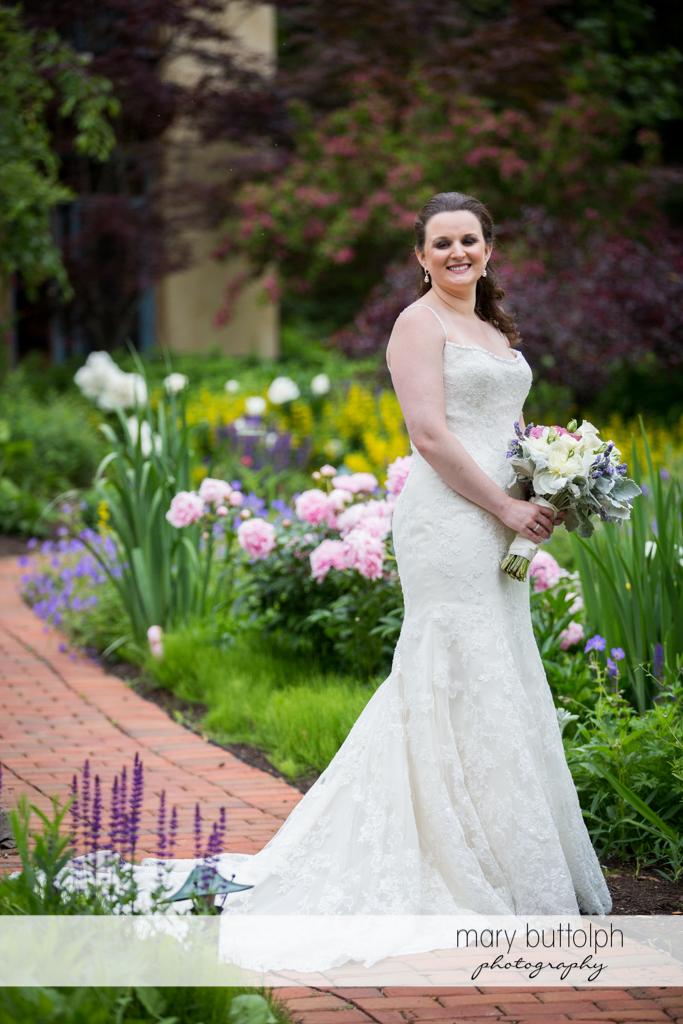 Bride in the garden at the Mirbeau Inn & Spa Wedding