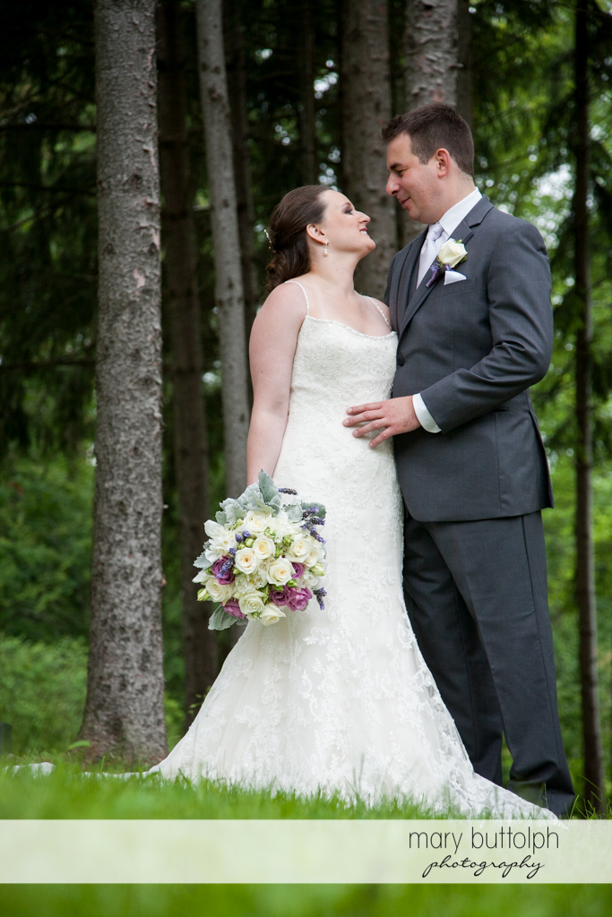 Couple spend time in the woods at the Mirbeau Inn & Spa Wedding