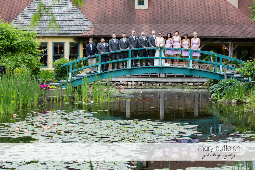 The wedding party on the wooden bridge at the Mirbeau Inn & Spa Wedding