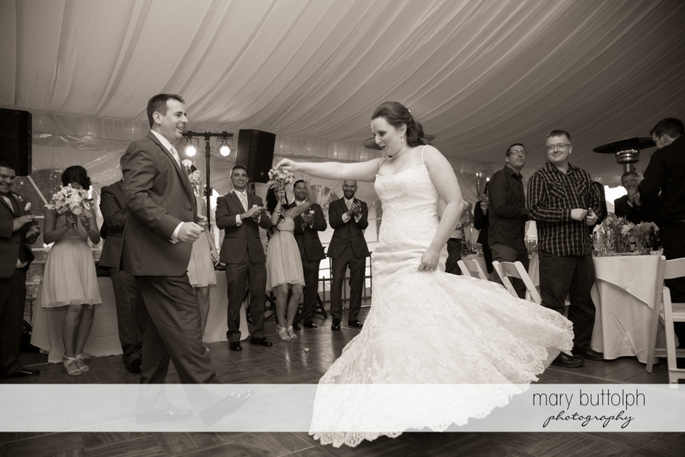 Couple dance as guests look on at the Mirbeau Inn & Spa Wedding