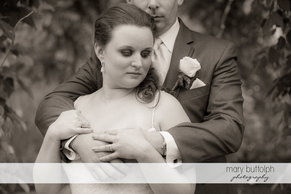 Couple in loving embrace at the Mirbeau Inn & Spa Wedding