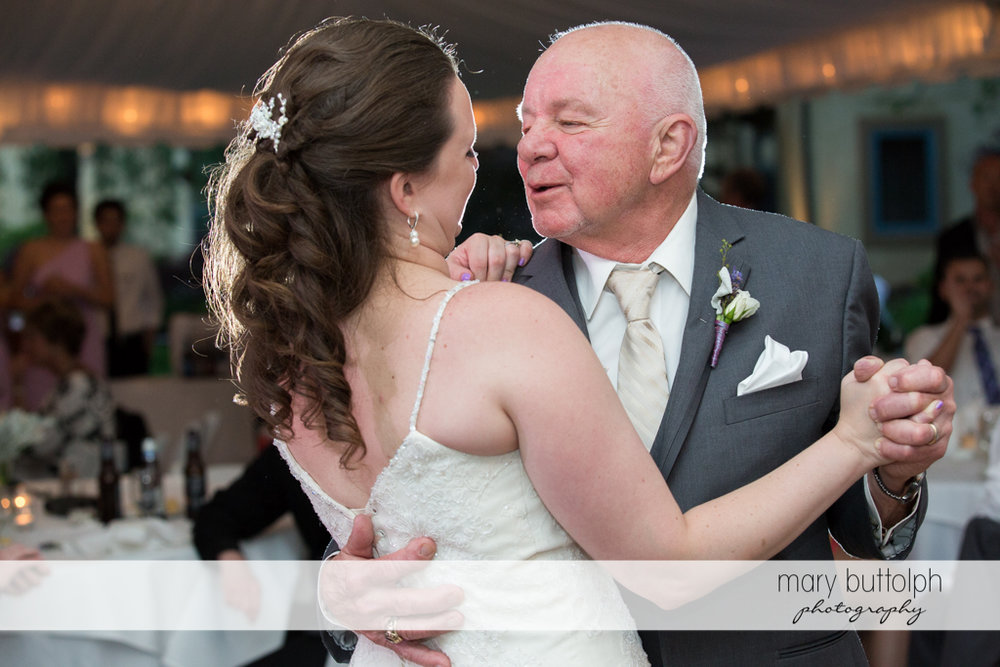 Bride dances with her father at the wedding venue at the Mirbeau Inn & Spa Wedding