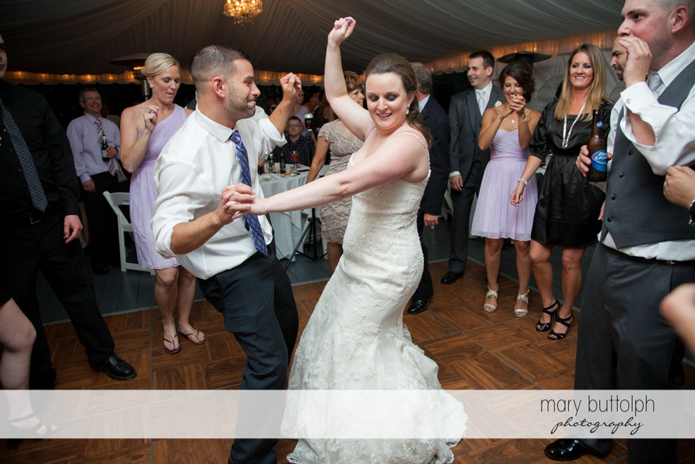 Bride shows her moves on the dance floor at the Mirbeau Inn & Spa Wedding