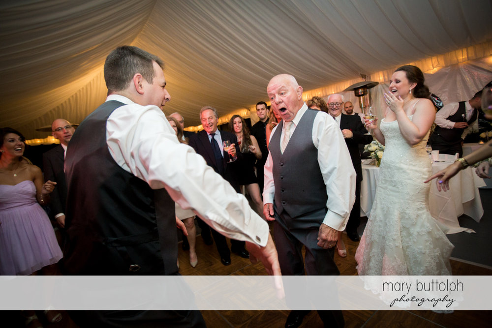 Groom shows the bride's father some dance moves at the Mirbeau Inn & Spa Wedding