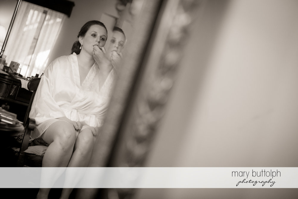 Bride's reflection in the mirror at the Mirbeau Inn & Spa Wedding