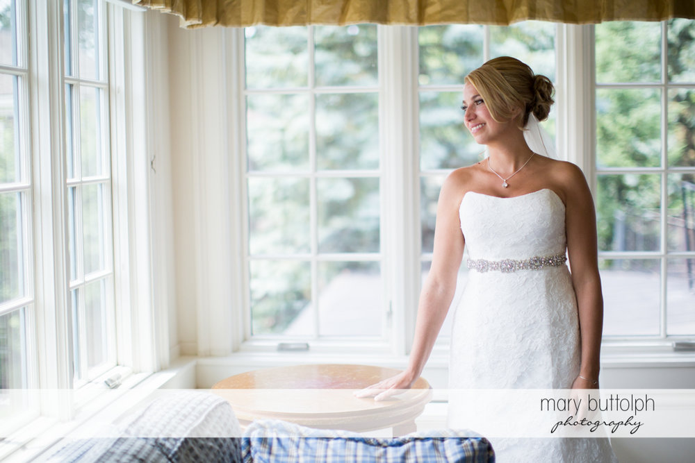 Bride looks out the window at the Sherwood Inn Wedding