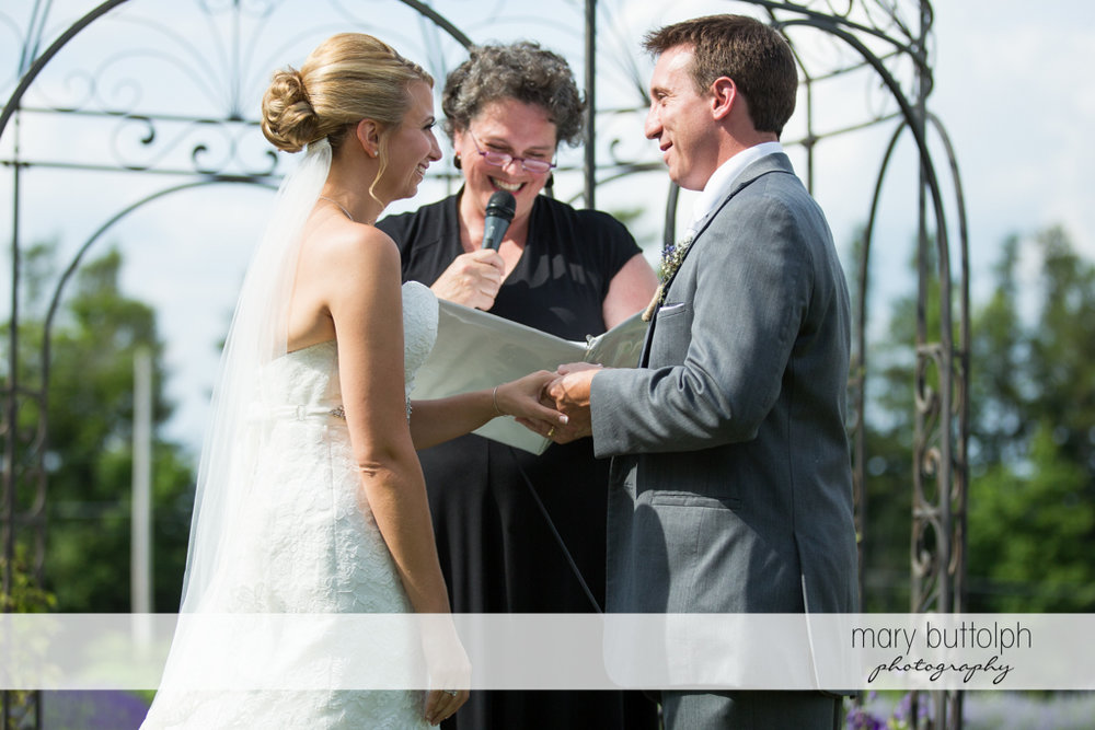 Couple hold hands in front of the wedding officiant at the Sherwood Inn Wedding