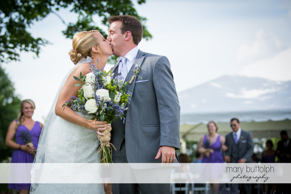 Couple kiss during the wedding ceremony at the Sherwood Inn Wedding