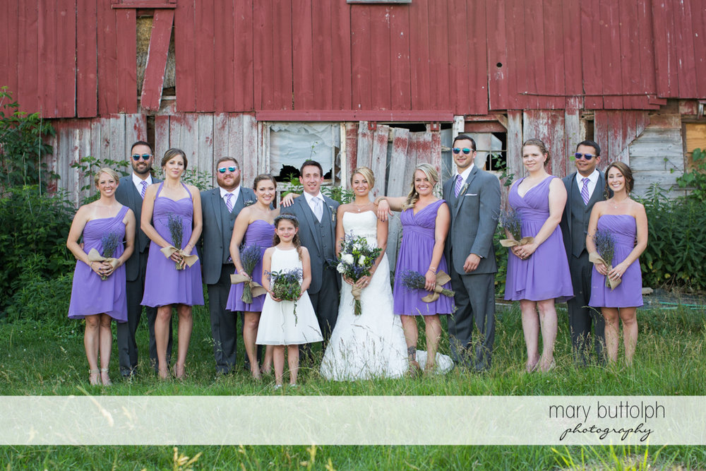 The wedding party in front of an old barn at the Sherwood Inn Wedding
