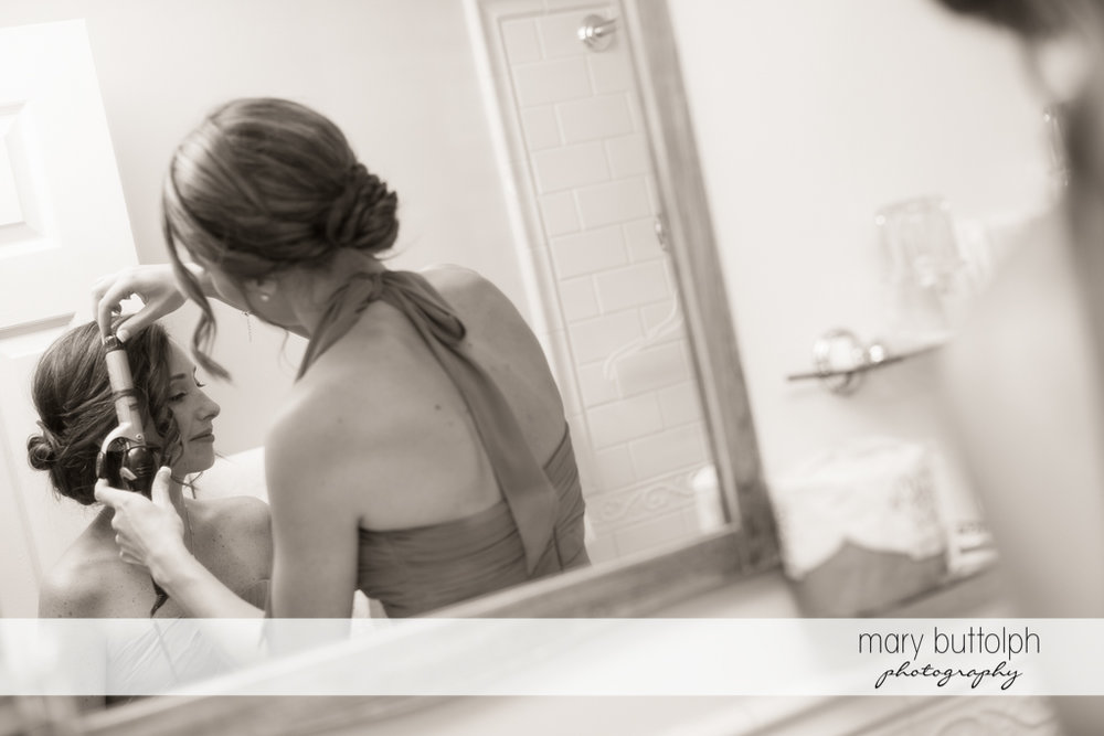 Bride's hair is fixed prior to the big event at the Sherwood Inn Wedding