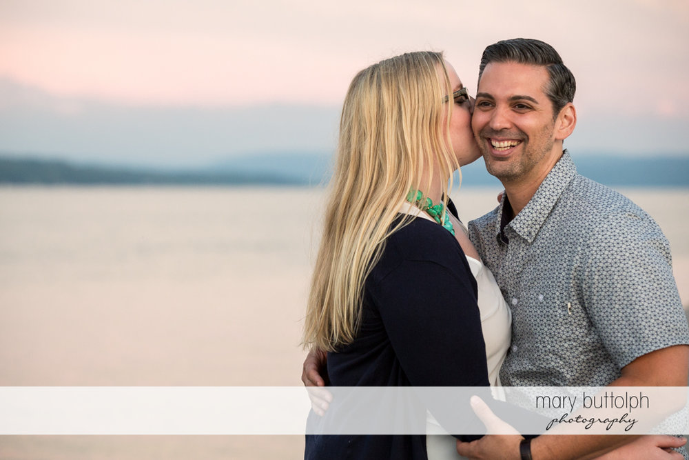 Man can't hide his happiness as he is kissed by the woman at Skaneateles Engagement
