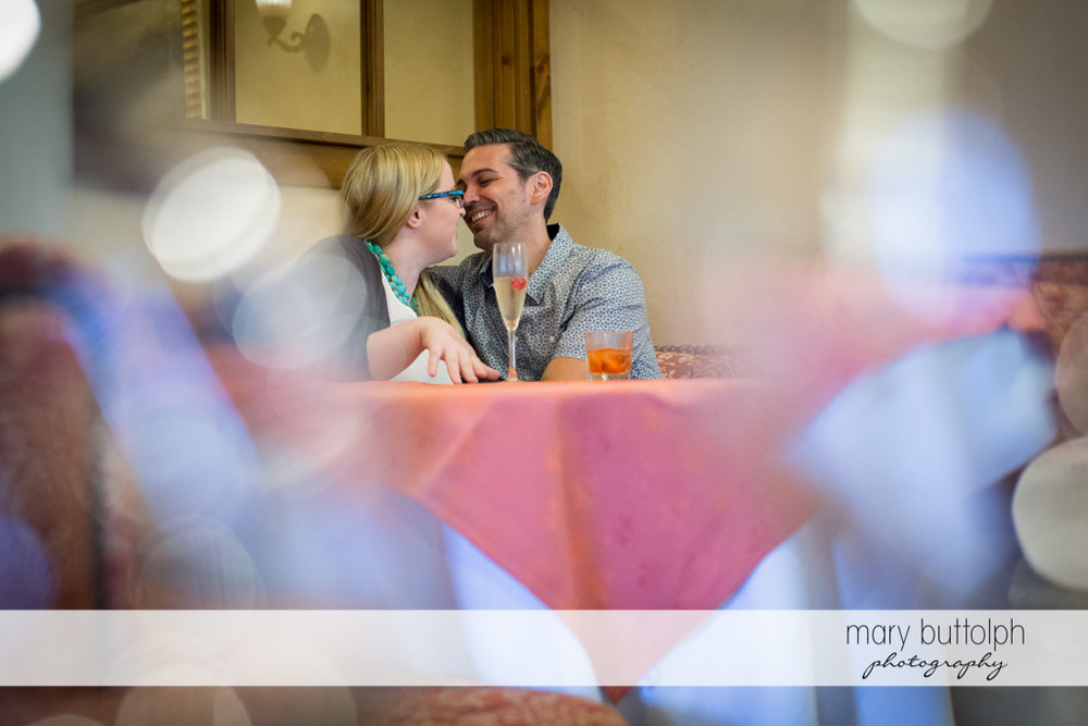 Couple share a table at the hotel at Skaneateles Engagement