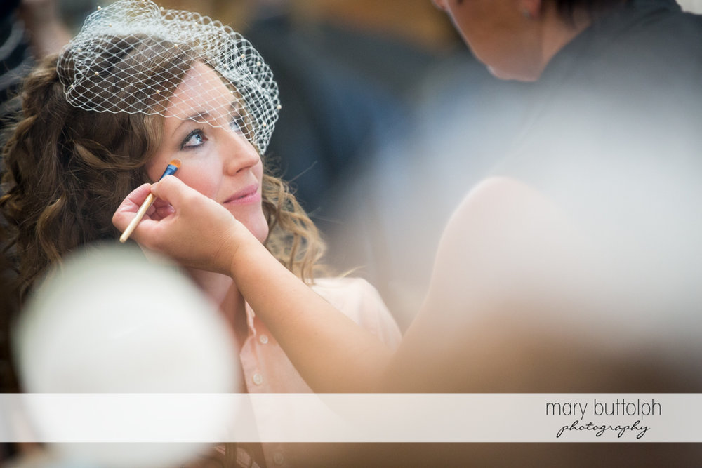 Bride gets a makeover at the Inns of Aurora Wedding