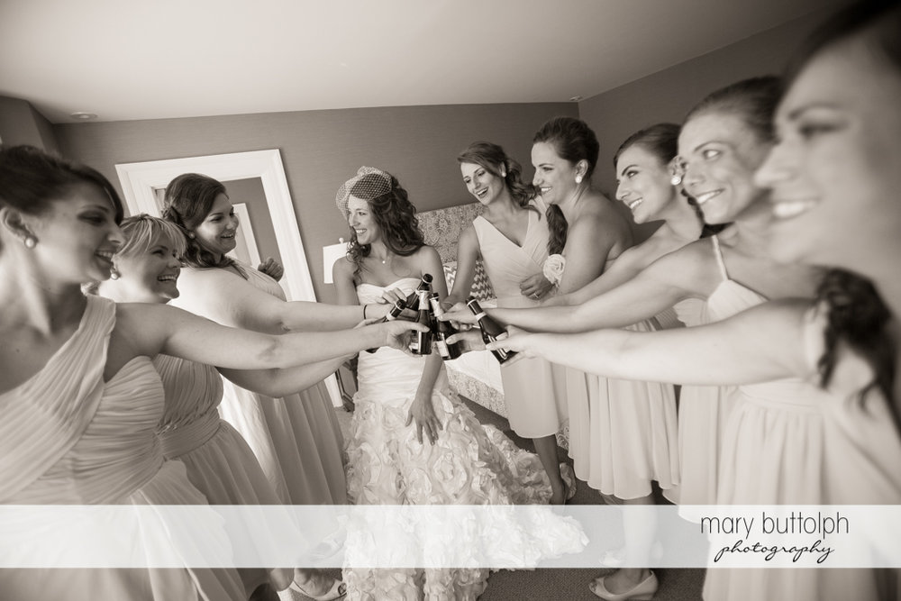 Bride and her bridesmaids toast to the good times at the Inns of Aurora Wedding
