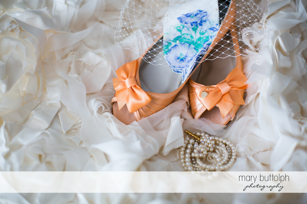 Bride's wedding shoes at the Inns of Aurora Wedding
