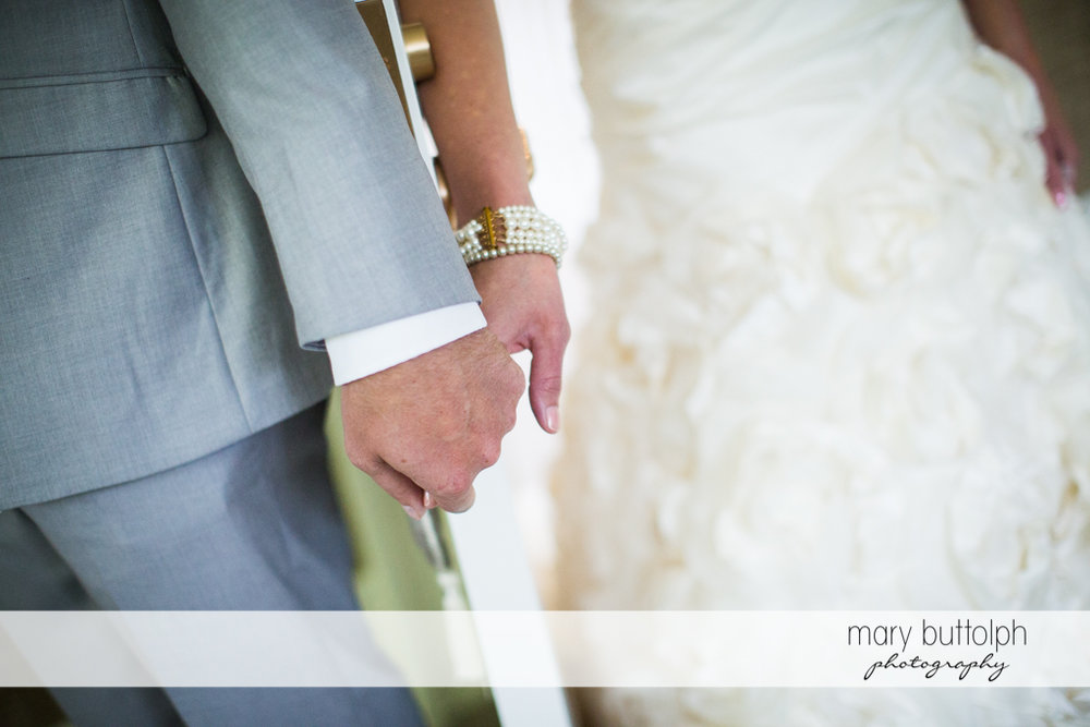 Couple hold hands at the Inns of Aurora Wedding