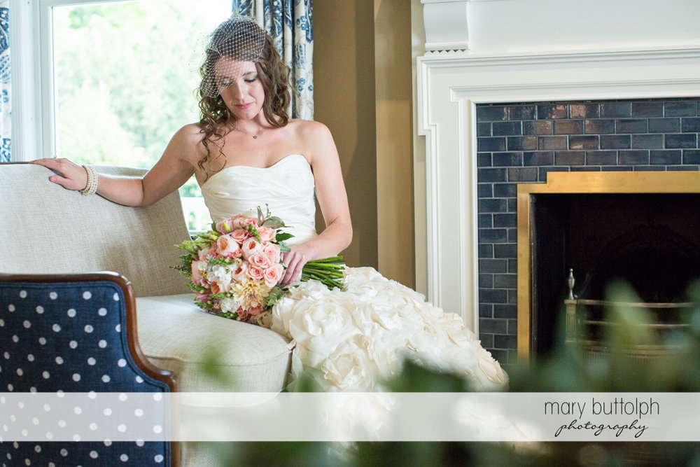 Bride relaxes near the fireplace at the Inns of Aurora Wedding