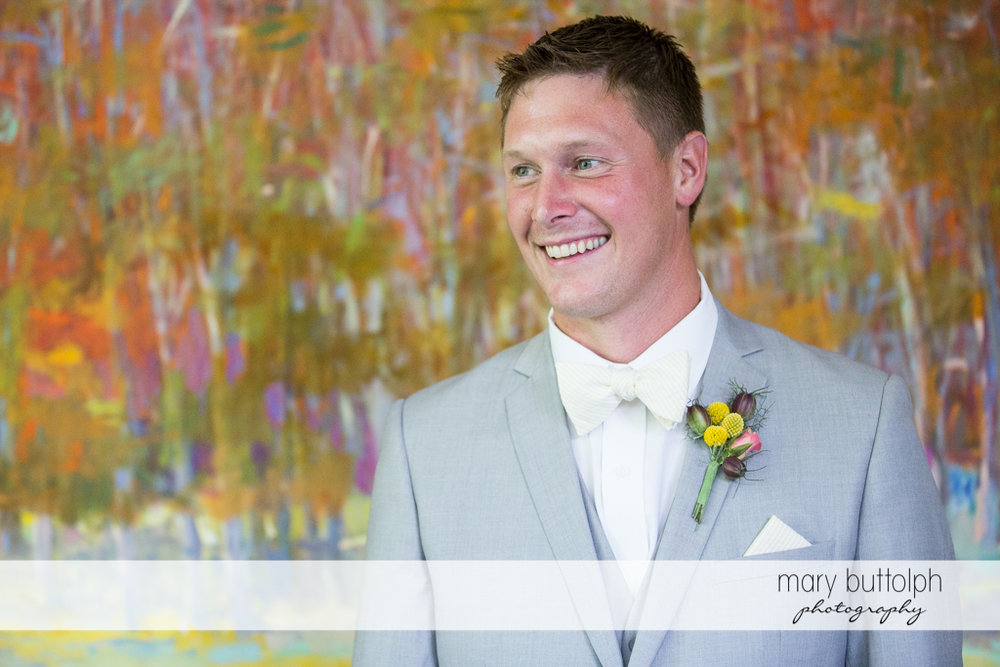 Smiling groom with colorful boutonniere at the Inns of Aurora Wedding