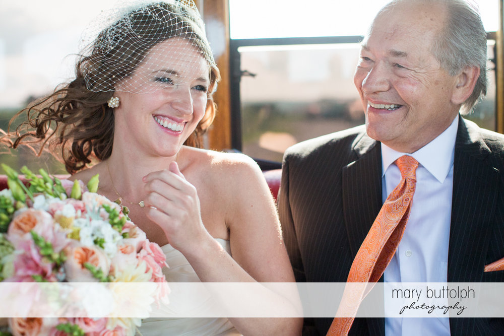 Bride shares a happy moment with her father at the Inns of Aurora Wedding