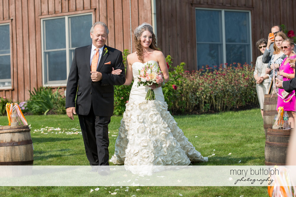 Bride is escorted by her father to the wedding venue at the Inns of Aurora Wedding