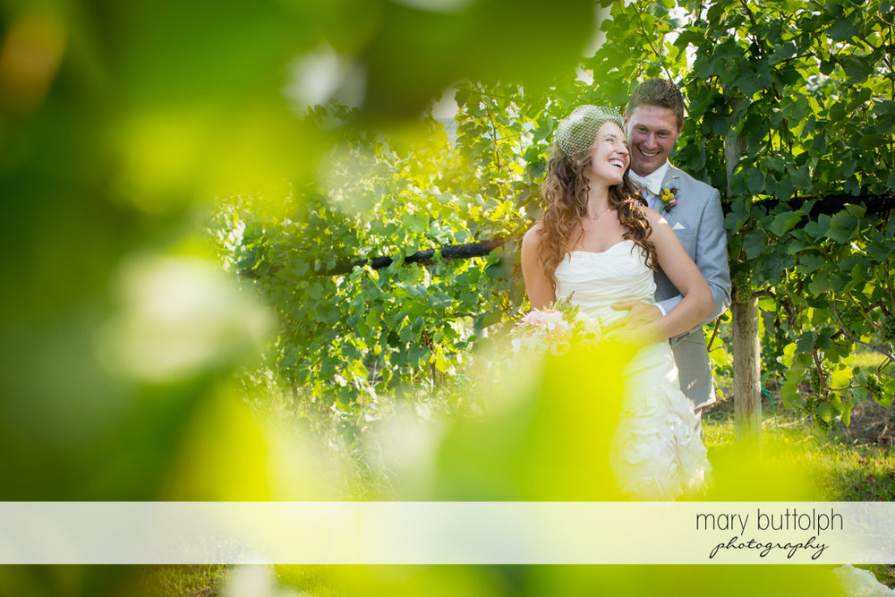 Another great shot of the couple in the vineyard at the Inns of Aurora Wedding