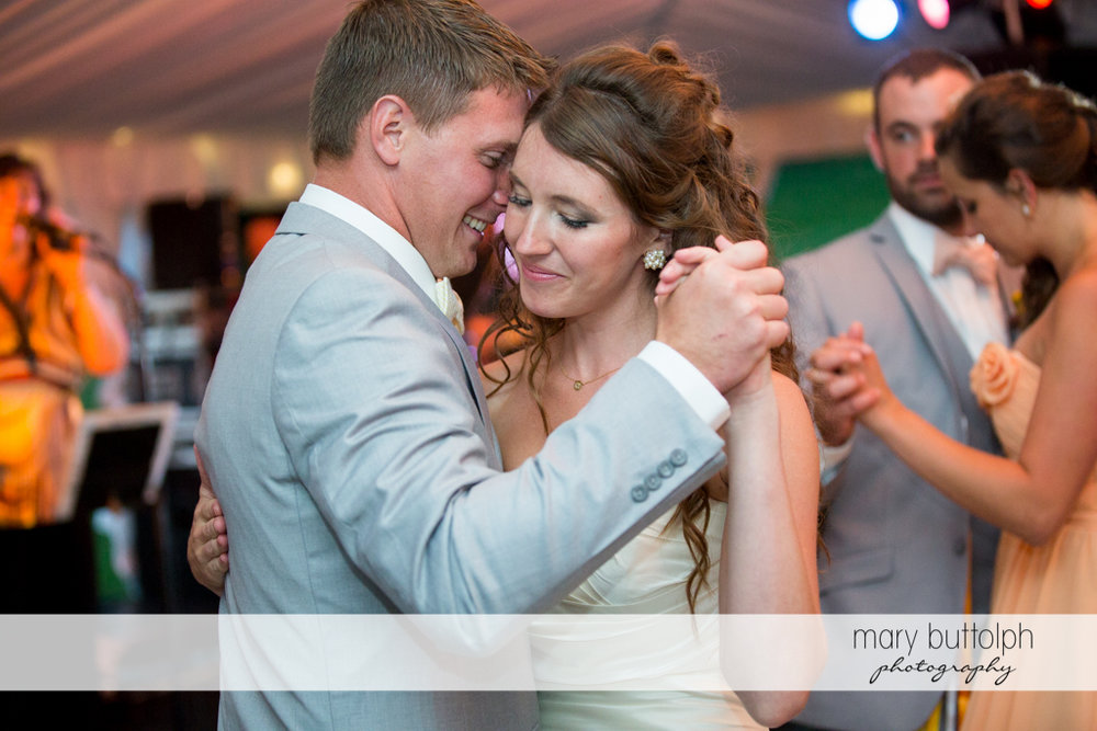 Couple get romantic while dancing at the Inns of Aurora Wedding