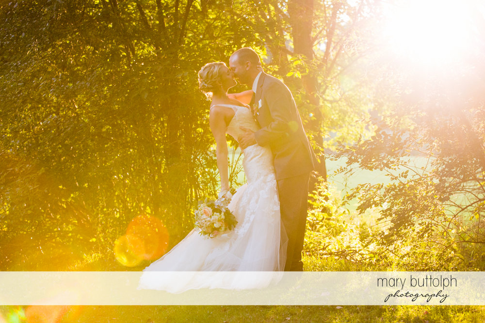 Couple rub noses in the woods at Arrowhead Lodge Wedding