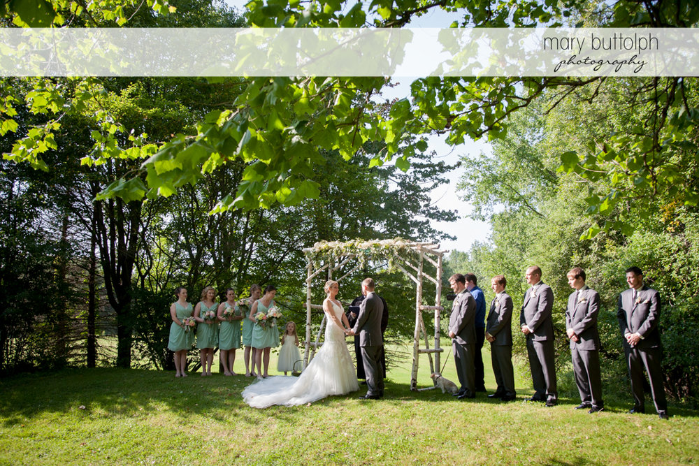 The wedding party in the garden at Arrowhead Lodge Wedding