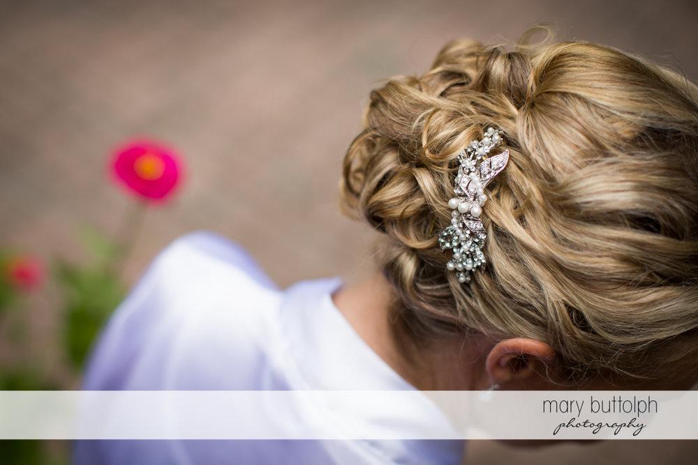 Close up shot of bride's hairpin at Arrowhead Lodge Wedding