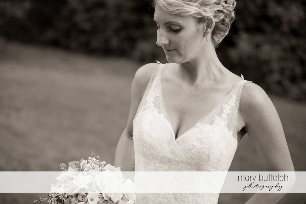 Dramatic black and white shot of the bride in the garden at Arrowhead Lodge Wedding