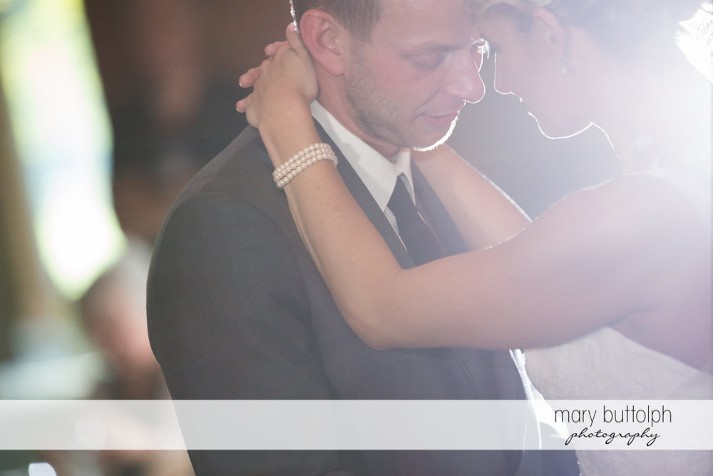 Couple get romantic while dancing at Arrowhead Lodge Wedding