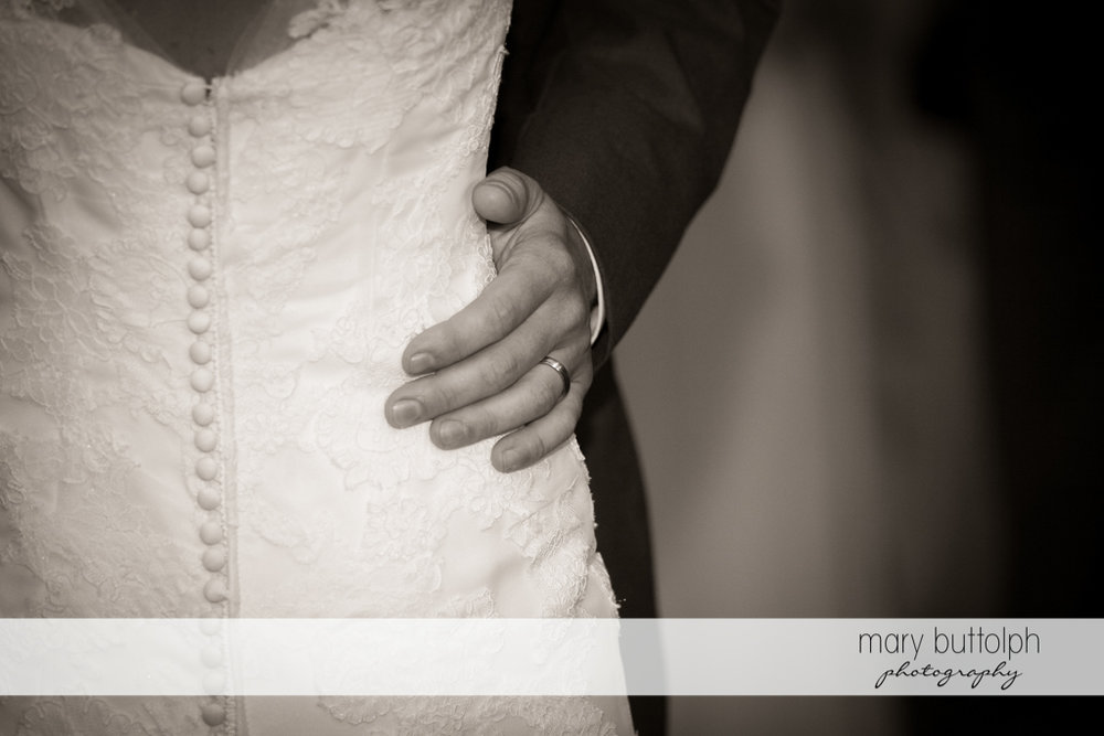 Groom's wedding ring is visible as he holds the bride while dancing at Arrowhead Lodge Wedding