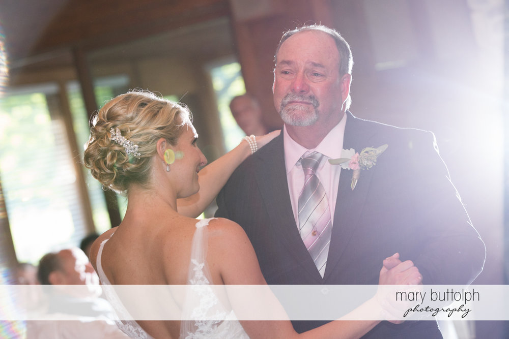 Bride dances with her father at the wedding venue at Arrowhead Lodge Wedding