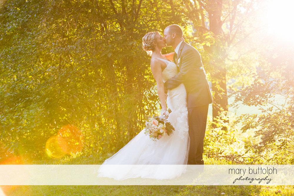 Couple kiss in the garden at Arrowhead Lodge Wedding