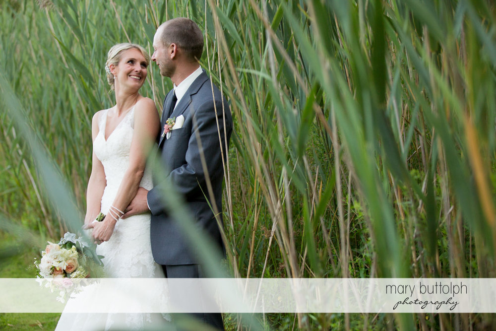 Couple pose in the garden at Arrowhead Lodge Wedding