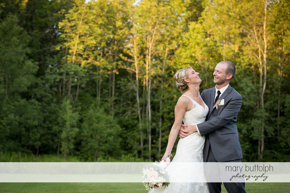 Couple share a happy moment in the garden at Arrowhead Lodge Wedding