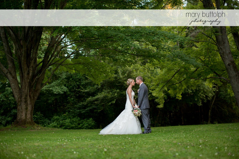 Couple see eye to eye in the garden at Arrowhead Lodge Wedding