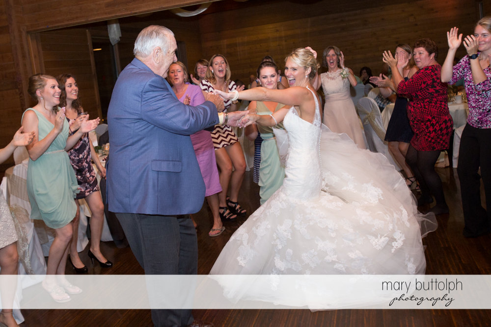 Bride and a guest dance at the wedding venue at Arrowhead Lodge Wedding