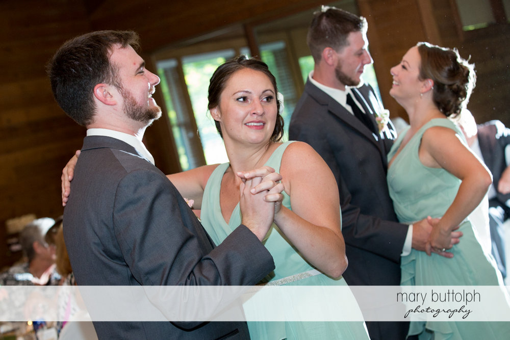 Groomsmen and bridesmaids show their dance moves at Arrowhead Lodge Wedding