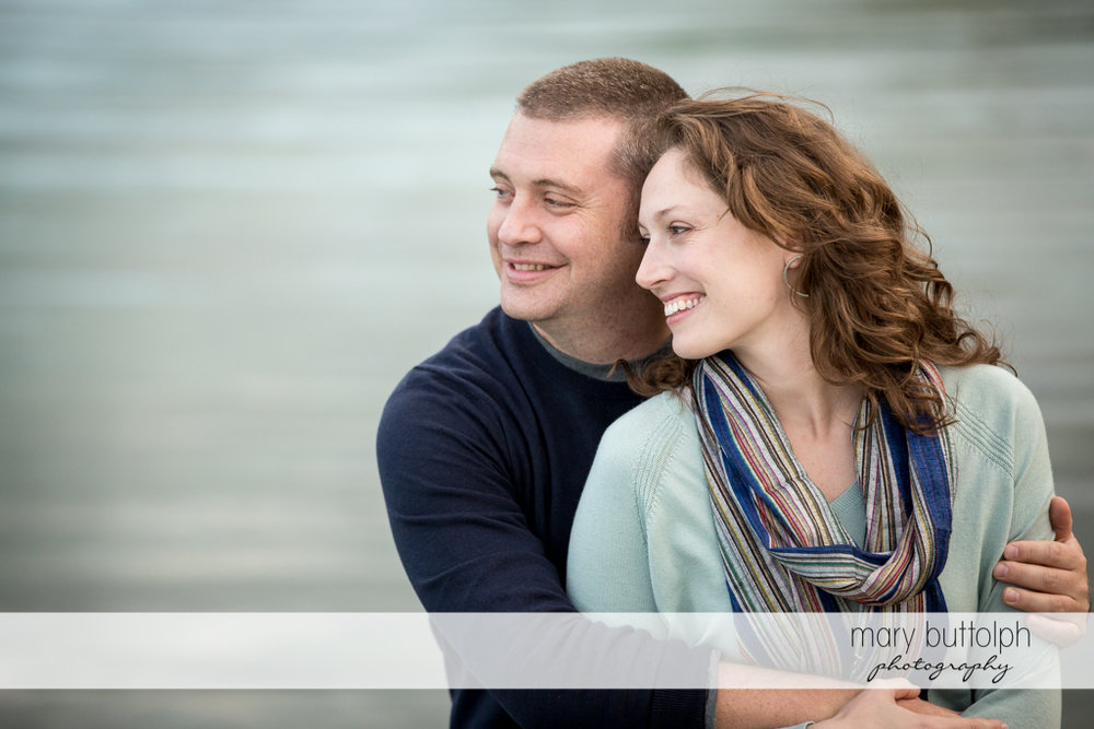 Couple pose by the lake at Green Lakes State Park Engagement
