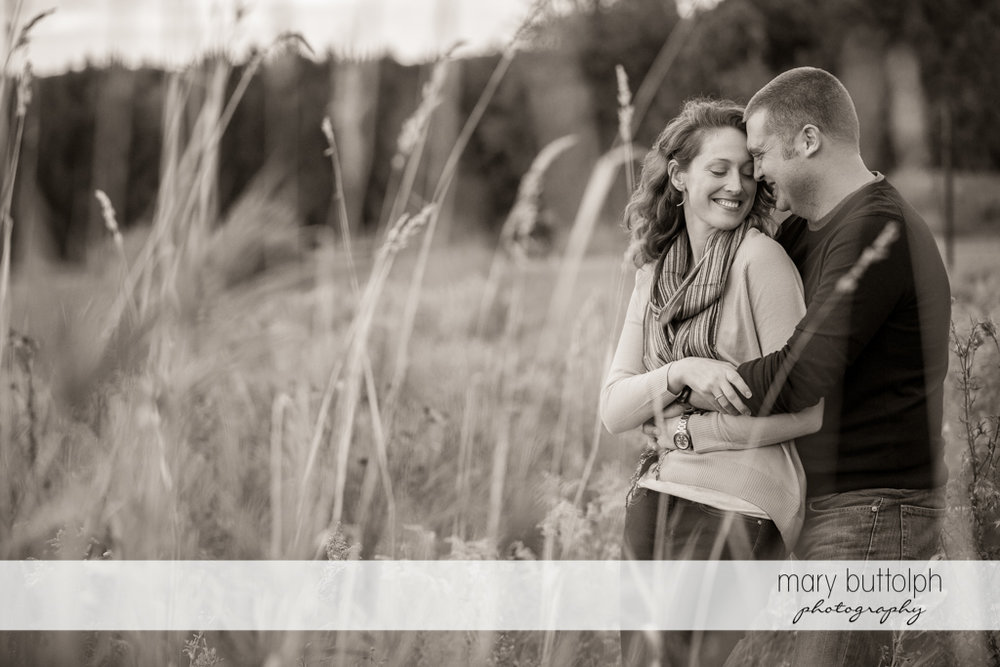 Couple relax in the park at Green Lakes State Park Engagement